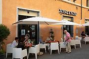 Restaurant street scene in the historic hill town of Spoleto, Umbria, Italy.