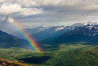Rainbow over peaks of the Chugach Mountains near Thompson Pass Alaska USA