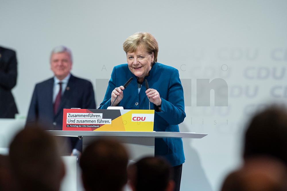 07 DEC 2018, HAMBURG/GERMANY:<br /> Angela Merkel, CDU, Bundeskanzlerin, geht noch einmal ans Rednerpult, nach Ihrer letzten Rede als Parteivorsitzende, CDU Bundesparteitag, Messe Hamburg<br /> IMAGE: 20181207-01-062<br /> KEYWORDS: party congress