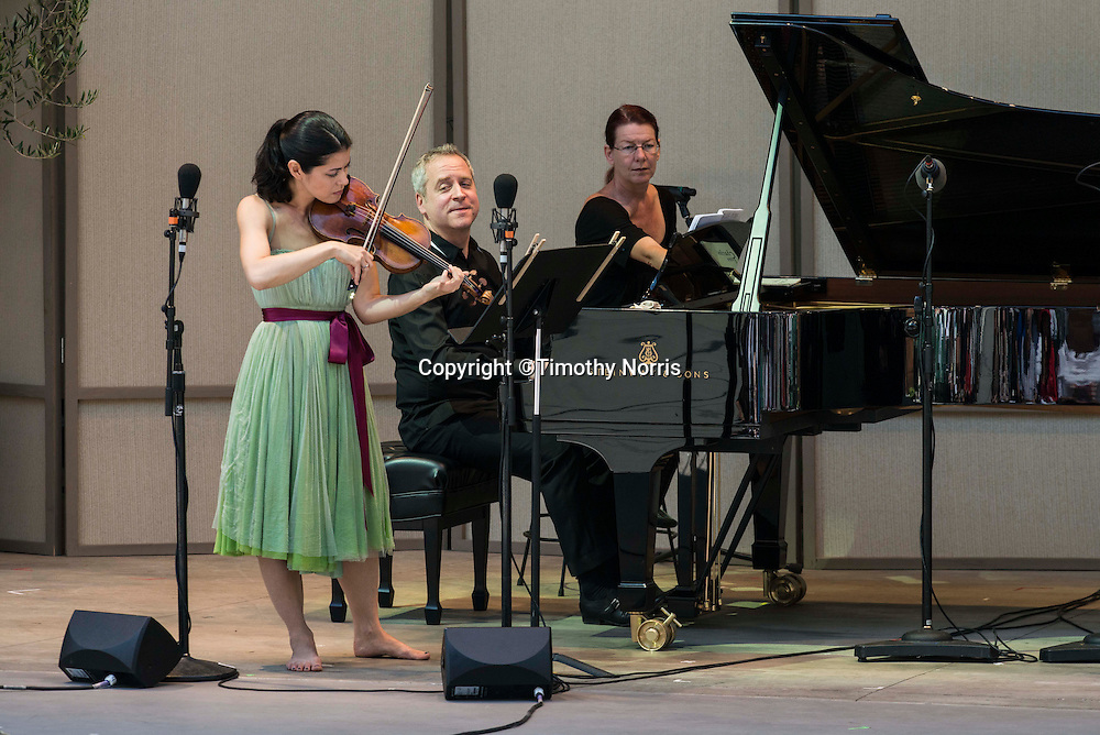 Jennifer Frautschi (violin) and Jeremy Denk (piano) perform Charles Ives' Sontas for Violin and Piano (complete) at the 68th Ojai Music Festival at Libbey Bowl on June 14, 2014 in Ojai, California.