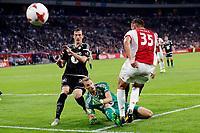 Fotball , 17. august k play-off Europa League , Ajax - Rosenborg BK ,  UEFA , <br /> Mitchell Dijks stuit op in duel met Rosenborg-keeper Andre Hansen<br /> <br /> Norway only