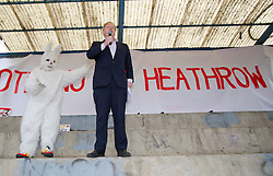 © London News Pictures. 27/03/2013. London, UK.  Mayor of London Boris Johnson, joined by a man dressed as a rabbit to represent wildlife threatened by the third runway, speaking at a Rally against Heathrow Expansion in Barnes, West London. Photo credit: Ben Cawthra/LNP