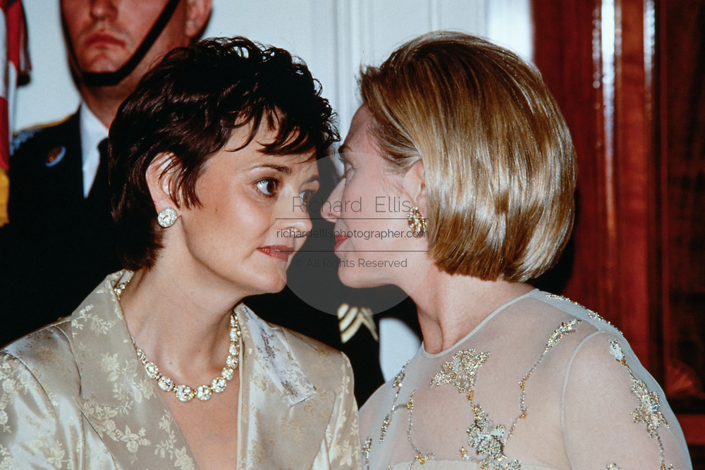 U.S. First Lady Hillary Clinton chats with Cherie Blair, wife of British Prime Minister Tony Blair, in the receiving line at the State Dinner at the White House February 5, 1998 in Washington, DC.