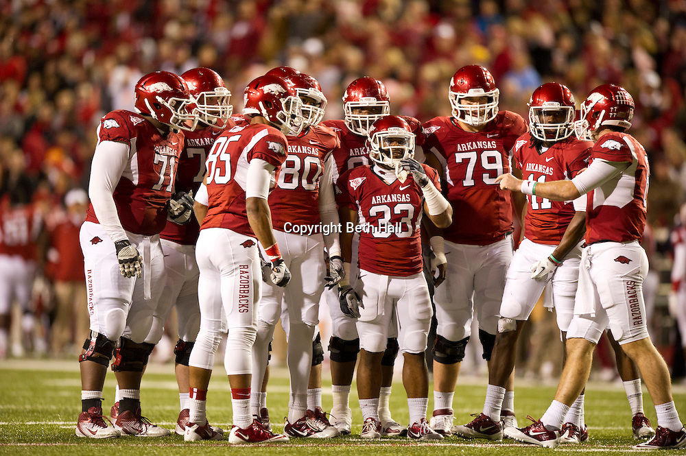 Nov 12, 2011; Fayetteville, AR, USA;  Arkansas Razorbacks offensive listens to quarterback Tyler Wilson (right) during a game against the Tennessee Volunteers at Donald W. Reynolds Razorback Stadium. Arkansas defeated Tennessee 49-7. Mandatory Credit: Beth Hall-US PRESSWIRE