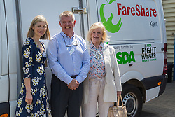 Kent Fareshare Operations Manager Paul Underdown poses for a picture with Kent High Sheriff Jane Ashton, left, and Mayor of Ashford Cllr Jessamy Blanford, right at the opening of FareShare's relocated warehouse in Ashford, Kent. Ashford, Kent, May 23 2019.