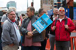 London, UK. 6th August, 2021. Members of the Unite trade union protest outside the Euston construction site for the HS2 high-speed rail link regarding trade union access to construction workers building tunnel sections for the project. Unite claims that HS2's joint venture contractor SCS, formed by Skanska, Costain and Strabag, has been hindering 'meaningful' trade union access to HS2 construction workers in contravention of the HS2 agreement.