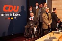 18 JAN 2000, BERLIN/GERMANY:<br /> Wolfgang Schäuble, CDU Parteivorsitzender, und hinter ihm Angela Merkel, CDU Generalsekretärin, auf dem Weg zur Pressekonferenz zu den Ergebnissen der Sitzung des CDU Bundesvorstandes in Verbindung mit der Parteispendenaffäre, Konrad-Adenauer-Stiftung<br /> Wolfgang Schaeuble, Chairman of the Christian Democratic Union (CDU), in his wheel-chair and behind him Angela Merkel General Secretary, on their way to the press conference about the results of the executive committees deliberations about the affair of secret donations to the CDU<br /> IMAGE: 20000118-01/01-27<br /> KEYWORDS: Parteispenden, Affäre, Logo, sign