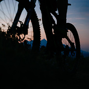 Andrew Whiteford rides the ridge of the Ferrin's Singletrack just after sunset above the town of Jackson with the Teton Range in the distance.