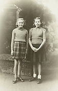 vintage studio portrait of two young girls age 13 England  1940s