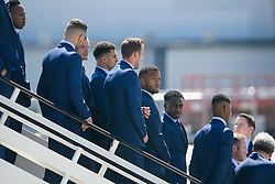 © Licensed to London News Pictures. 06/06/2016. Luton, UK. Members of England national football squad chat as they wait to board a plane at Luton airport in Bedfordshire, England, to head for their training camp in France, ahead of the start of the UEFA Euro 2016 championships.  Photo credit: Ben Cawthra/LNP