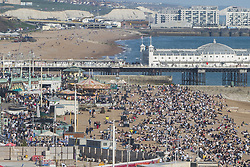 April 18, 2018 - Brighton, East Sussex, United Kingdom - Brighton, UK. Brighton beach seen from the BA I360 viewing attraction. Members of the public take to the beach in Brighton and Hove as sunny and warmer weather continues to hit the seaside resort. (Credit Image: © Hugo Michiels/London News Pictures via ZUMA Wire)
