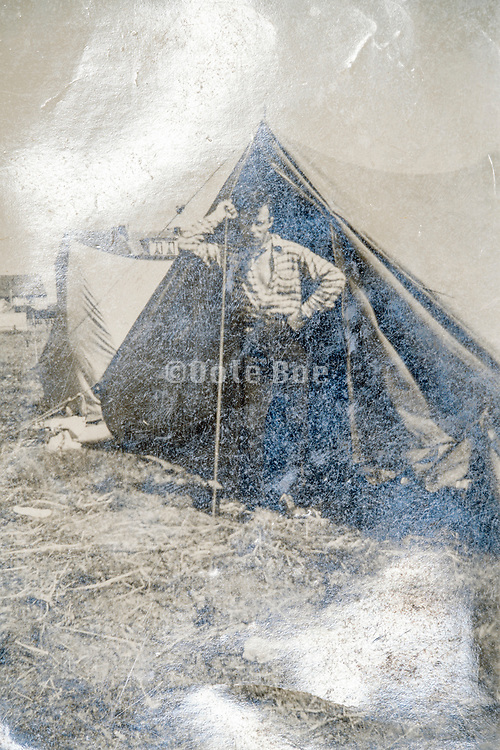 young adult man posing by tent ca 1940s