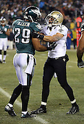 Philadelphia Eagles strong safety Nate Allen (29) gets into a scrap with New Orleans Saints wide receiver Lance Moore (16) during the NFL NFC Wild Card football game against the New Orleans Saints on Saturday, Jan. 4, 2014 in Philadelphia. The Saints won the game 26-24. ©Paul Anthony Spinelli