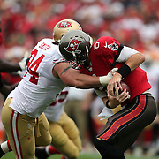 San Francisco 49ers defensive end Justin Smith (94) sacks Tampa Bay Buccaneers quarterback Mike Glennon (8) during an NFL football game between the San Francisco 49ers  and the Tampa Bay Buccaneers on Sunday, December 15, 2013 at Raymond James Stadium in Tampa, Florida.. (Photo/Alex Menendez)