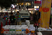 Police and volunteers  help to keep Shibuya clean and safe during the Halloween celebrations Shibuya, Tokyo, Japan. Saturday October 27th 2018. The celebrations marking this event have grown in popularity in Japan recently. Enjoyed mostly by young adults who like to dress up, drink , dance and misbehave in parts of Tokyo like Shibuya and Roppongi. There has been a push back from Japanese society and the police to try to limit the bad behaviour.