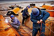 Workers at dong Feng ship yard in Chongqing, China, on monday 21. jan, 2008