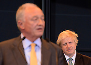 © London News Pictures. 04/05/2012. London, UK. KEN LIVINGSTONE speaks after loosing the mayoral election to  BORIS JOHNSON (rear) at London City Hall on May 4, 2012. Johnson, a Conservative member of Parliament, defeated Ken Livingstone to become mayor of London for a second term. Photo credit: Stephen Simpson/LNP