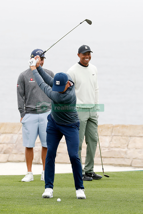 June 12, 2019 - Pebble Beach, CA, U.S. - PEBBLE BEACH, CA - JUNE 12: PGA golfer Tiger Woods watches Jordan Spieth hit his shot on the 18th hole during a practice round for the 2019 US Open on June 12, 2019, at Pebble Beach Golf Links in Pebble Beach, CA. (Photo by Brian Spurlock/Icon Sportswire) (Credit Image: © Brian Spurlock/Icon SMI via ZUMA Press)