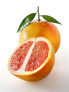 Fresh whole and cut pink grapefruit