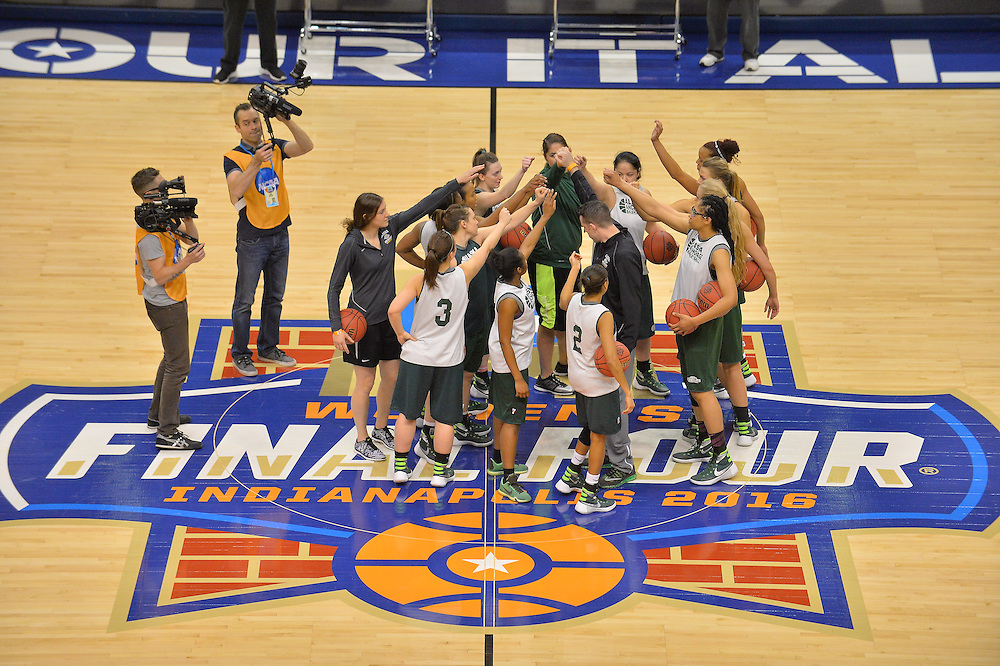 April 2, 2016; Indianapolis, Ind.; The UAA women's basketball team gathers at center court after their practice session at Bankers Life Fieldhouse.