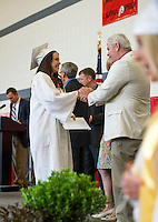 Jada Marie Staples is congratulated by Principal Jim McCollum during Laconia High School's 135th commencement ceremony at Laconia Middle School Saturday morning.  (Karen Bobotas/for the Laconia Daily Sun)