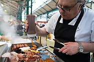 "A traditional Belfast ""Bap"" breakfast sandwich at St. George's Market, Belfast, Northern Ireland"