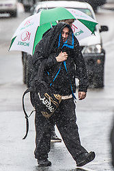© Licensed to London News Pictures. 19/05/2016. Aberystwyth, Wales, UK. People shelter under umbrellas and make-shod hoods as the rain pours down on the streets of Aberystwyt After days of fine sunshine, the weather breaks today as bands of wet and windy weather hit the west coast of Wales, and spread eastwards to affect much of the UK .  Photo credit: Keith Morris/LNP