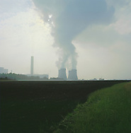 Steam rising from the cooling towers of Fiddler's Ferry power station in Widnes on the river Mersey as seen across farm fields from Penketh. The Mersey is a river in north west England which stretches for 70 miles (112 km) from Stockport, Greater Manchester, ending at Liverpool Bay, Merseyside. For centuries, it formed part of the ancient county divide between Lancashire and Cheshire.