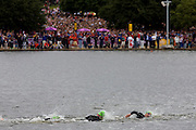Swimmers race through the waters of London's Serpentine lake for the Mens' Triathlon cmpetition in Hyde Park during the London 2012 Olympics, the 30th Olympiad. The Triathlon competitors raced over a 1.5km swim, a 43km bike race and a 10km run - eventually won by Team GB's Alistair Brownlee, Spain's Javier Gomez and Jonathan Brownlee (brother of the winner). The Serpentine (also known as the Serpentine River) is a 28-acre (11 ha) recreational lake in Hyde Park, London, England, created in 1730. The venue was the Hyde Park 142 hectares (350 acres) Hyde Park in the heart of the capital, one of the largest parks in central London and the site of the Victorian Great Exhibition of 1851.