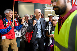 © Licensed to London News Pictures. 04/09/2018. London, UK. CHRIS WILLIAMSON MP (centre) joins pro Jeremy Corbyn protestors outside Labour Party headquarters in London ahead of a National Executive Committee meeting. The Labour Party's ruling body is expected to vote on whether to adopt, in full, the IHRA (International Holocaust Remembrance Alliance) definition of anti-Semitism. Photo credit: Ben Cawthra/LNP
