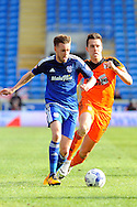 Cardiff City's Craig Noone (l) takes on Ipswich's Jonas Knudsen. Skybet football league championship match, Cardiff city v Ipswich Town at the Cardiff city stadium in Cardiff, South Wales on Saturday 12th March 2016.<br /> pic by Carl Robertson, Andrew Orchard sports photography.