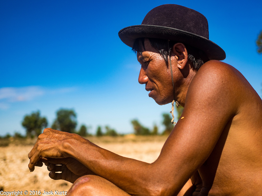 02 JUNE 2016 - SIEM REAP, CAMBODIA:  LERN, who has been farming all his life, rests on the side of his rice fields near Seam Reap. Cambodia is in the second year of  a record shattering drought, brought on by climate change and the El Niño weather pattern. Lern said this is driest he has ever seen his fields. He said he is planting because he has no choice but if they rainy season doesn't come, or if it's like last year's very short rainy season he will lose his crops.     PHOTO BY JACK KURTZ