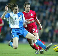 Fotball<br /> Premier League England 2004/2005<br /> 21.11.2004<br /> Foto: SBI/Digitalsport<br /> NORWAY ONLY<br /> <br /> Blackburn v Birmingham<br /> Barclays Premiership. 21/11/2004. <br /> <br /> David Dunn of Birmingham City is challenged by Nils-Eric Johansson of Blackburn Rovers.