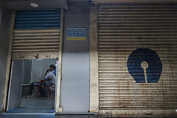 KOLKATA, Nov. 9, 2016 (Xinhua) -- An Indian security personnel guards inside a closed ATM in Kolkata, capital of eastern Indian state West Bengal, Nov. 9, 2016. India Tuesday night abolished currency notes of 500 and 1,000 denomination in one of the biggest revolutionary monetary reforms since independence, aimed at curbing the menace of black money. All ATMs and banks remain shut on Wednesday and Thursday. (Xinhua/Tumpa Mondal).****Authorized by ytfs* (Credit Image: © Tumpa Mondal/Xinhua via ZUMA Wire)