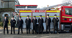 © Licensed to London News Pictures. 11/11/2012..Saltburn, Cleveland, England..The Remembrance Day parade and service takes place in the Cleveland seaside town of Saltburn by the Sea..Part time Firefighters from the station in Saltburn stand on parade during the service...Photo credit : Ian Forsyth/LNP
