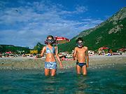 Model released two children going snorkelling in the sea, Olu Deniz, Turkey
