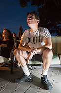 """Merrick, New York, USA. 11th June 2017.  CHRIS EDOM, """"American Grit"""" TV series contestant, 48, of Merrick, wears GOT GRIT? T-shirt as he sits in his backyard with family, friends, neighbors, athis Viewing Party for Season 2 premiere of the FOX network reality television series."""