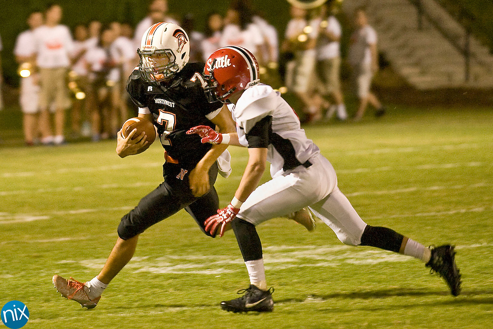 Trojans wide receiver Damien Bertino (7) tries to get past a Raiders defender during the South Rowan Raiders at Northwest Cabarrus Trojans high school football game Friday night.