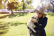 Mature women holding dog in park