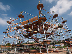 Modern  new outdoor adventure playground featuring multi-level climbing and obstacle courses in Berlin Germany