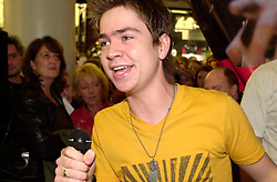 Pop Idol Sam Nixon brings Barnsley to a stand still when he makes a personal appearance the The Mall Alahambra Shopping centre in his home town of Barnsley South Yorkshire<br />24 November 2003<br /><br />image copyright Paul David Drabble<br /><br /><br /> [#Beginning of Shooting Data Section]<br />Nikon D1 <br /> 2003/11/24 16:30:05.5<br /> JPEG (8-bit) Fine<br /> Image Size:  2000 x 1312<br /> Color<br /> Lens: 17-35mm f/2.8-4<br /> Focal Length: 34mm<br /> Exposure Mode: Manual<br /> Metering Mode: Spot<br /> 1/160 sec - f/4<br /> Exposure Comp.: 0 EV<br /> Sensitivity: ISO 800<br /> White Balance: Auto<br /> AF Mode: AF-S<br /> Tone Comp: Normal<br /> Flash Sync Mode: Front Curtain<br /> Auto Flash Mode: External<br /> Color Mode: <br /> Hue Adjustment: <br /> Sharpening: Normal<br /> Noise Reduction: <br /> Image Comment: <br /> [#End of Shooting Data Section]