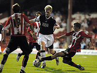 Photo: Ed Godden.<br /> <br /> Brentford v Swansea City. Coca Cola League 1. 12/09/2006. Swansea's Alan Tate (centre) surges forward.