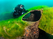 LungFish rebreather diver on the Aircraft Cessna wreck covered with green algae at Dutch Springs, Scuba Diving Resort in Pennsylvania