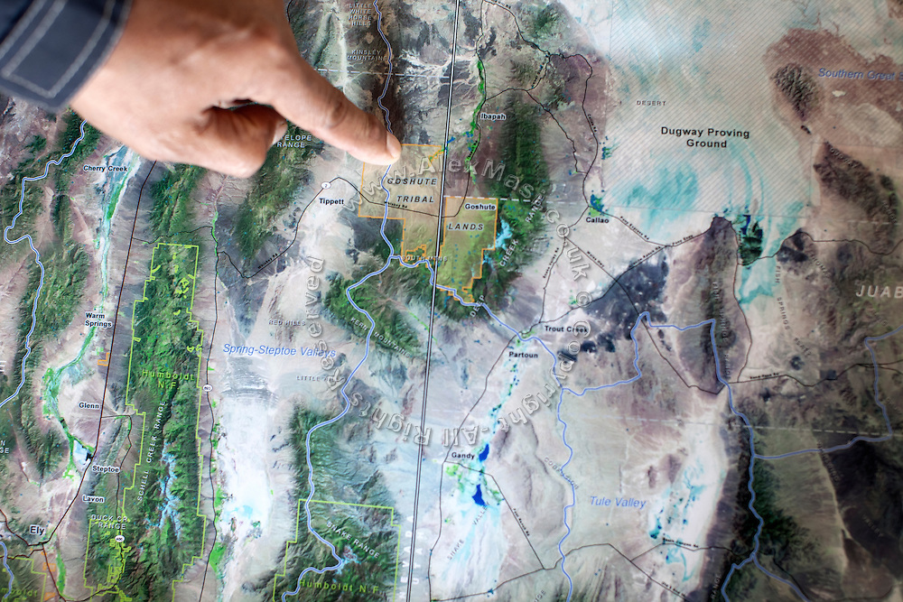 Rupert Steele, former chairman of the Goshute Tribe, is pointing to the location of the Goshute Reservation on a map inside the Tribal Headquarters of Deep Creek Valley, on the Nevada-Utah border, USA.