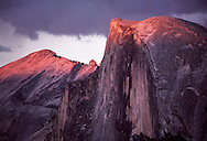 Fading afternoon light produces an alpenlgow on the summit of Half Dome and Cloud's Rest in Yosemite National Park.