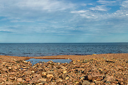 The rocky shoreline just before dusk looking across Lake Superior near Duluth Minnesota