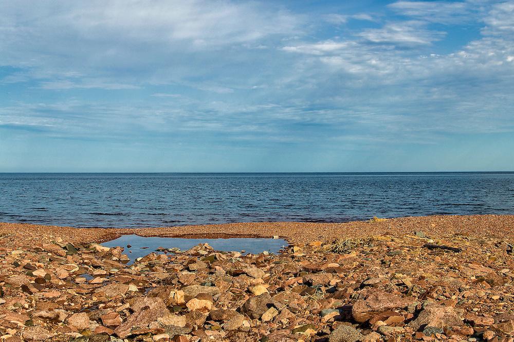 The rocky shoreline just before dusk looking across Lake Superior near Duluth Minnesota