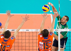 Milan Rasic of ACH and Carlos Moreno of ACH vs Dore Della Lunga of Cuneo during volleyball match between ACH Volley Ljubljana and Bre Banca Lannutti Cuneo (ITA) in Playoff 12 game of CEV Champions League 2012/13 on January 15, 2013 in Arena Stozice, Ljubljana, Slovenia. (Photo By Vid Ponikvar / Sportida.com)