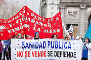 Health care staff holding banners near Cibeles,Madrid.