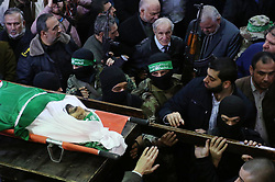 January 30, 2018 - Gaza City, Gaza Strip, Palestinian Territory - Palestinian militants from the Ezzedine al-Qassam Brigades, the armed wing of the Hamas movement carry the body of Hamas senior leader Imad al-Alami during his funeral at the al-Omari mosque in Gaza City on January 30, 2018. A senior Hamas official has died in Gaza three weeks after shooting himself in the head in what officials described as an accident, the Palestinian Islamist group announced. Alami was wounded on January 9 while ''inspecting his personal weapon in his home'' in Gaza, Hamas said at the time  (Credit Image: © Ashraf Amra/APA Images via ZUMA Wire)